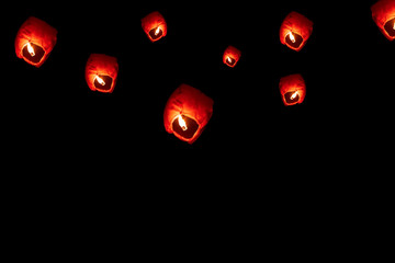 Flying Paper Sky Lantern On Diwali. Sky lanterns isolated on Black background with copy space. Diwali and New Year festival floating lamps at night sky.