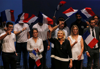France's far-right leader Marine Le Pen delivers a speech for the next year's municipal elections in an end-summer annual address to partisans in Frejus