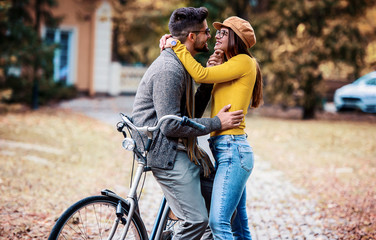 Meeting in the park. Romantic couple in the autumn park. Love, dating, romance
