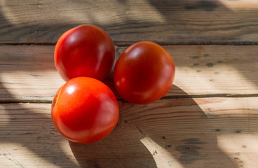 Close up image of tomatoes on old wooden background