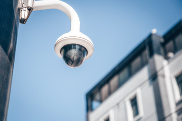 Modern surveillance cameras on the street. Cctv equipment. Blue sky on the background. Protection and control concept.