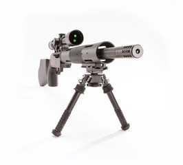 Front view in studio of a 22 caliber rifle with bipod and optic.