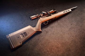 22 caliber rifle with studio lighting.