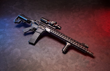Studio pic of an AR 15 style rifle.