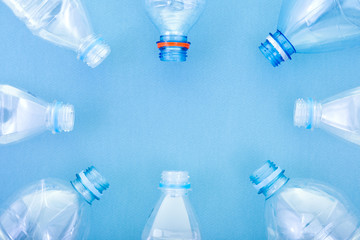 plastic bottles on a blue cardboard background. concept ecology and science. free space for text