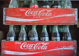 Missouri, Usa - July 19, 2017: Two old wooden boxes with coca cola bottles. Coca-Cola is a carbonated soft drink produced by The Coca-Cola Company.