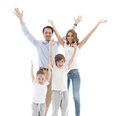 Happy family with raised hands