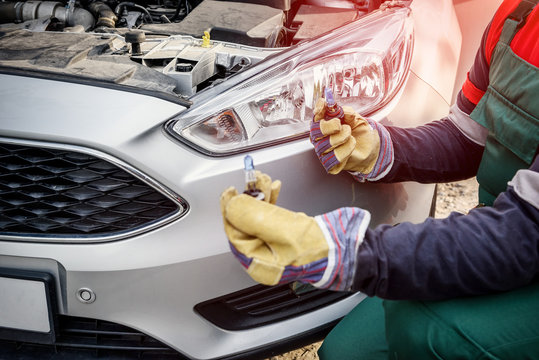 Human hands in protective gloves with headlamps