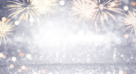 Fototapete - New Year Abstract background holiday, Gold and silver Fireworks and bokeh, copy space.
