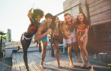 Group of friends having fun on the rooftop of a beautiful penthouse