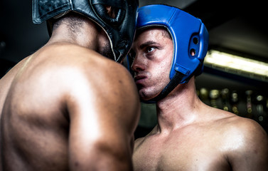 Two boxers face to face ready to fight