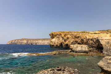 Panorama view at the coast of Dwejra Bay with the ruin of Azure Window on Gozo island in Malta