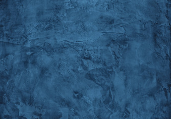 Navy blue colored dark Concrete textured background with roughness and irregularities to your design or product. Color trend concept.