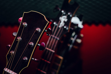 A set of classical and electric guitars. Music concept. Guitars for musicians, sale of guitars, musical instruments. Playing musical instruments, creating.