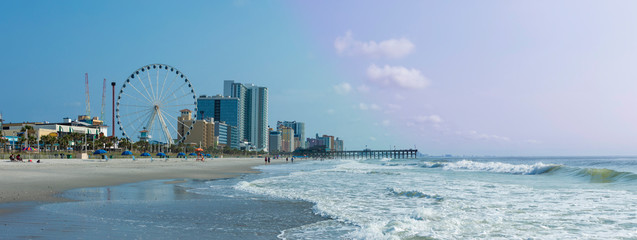 Panoramic view of Myrtle Beach, South Carolina with beach, hotels, ferris wheel, and boardwalk.