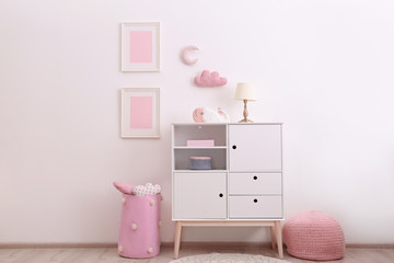 Nursery room interior with cabinet and toys