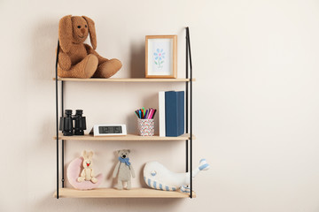 Shelves with toys and kids stuff in child room. Space for text
