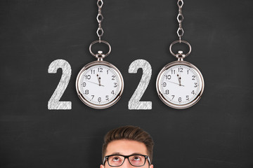 New year concepts 2020 countdown clock over human head on blackboard background