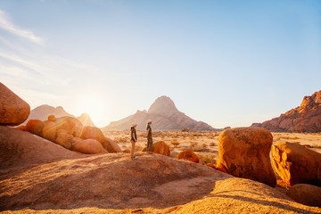 Kids hiking in Spitzkoppe Namibia Wall mural