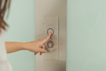 people 's hand pressing the lift button for background. Wall mural