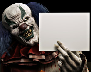 Frightening scary clown with sharp fangs piercing the darkness holding a black advertisment card with room for your text or copy space. 3d rendering