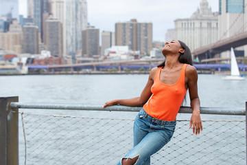 Pretty African American woman near Hudson River in New York