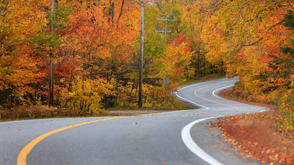 Scenic road through Quebec countryside in autumn time