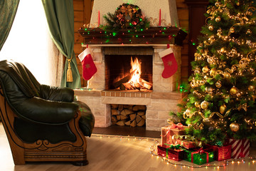 Christmas living room interior in the day time with decorated fireplace, armchair and xmas tree