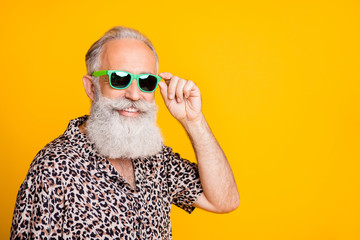 Close up photo of old man having fun funky funny rest under sun while isolated with yellow background