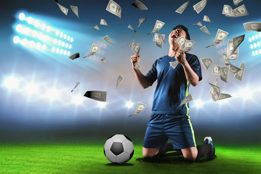 Footballer rejoices at the stadium for winning a rich soccer bet - Image