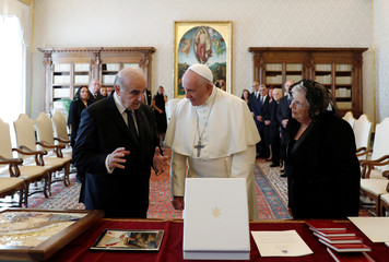Pope Francis exchanges gifts with Maltese President George Vella and his wife Miriam Vella during a private audience at the Vatican