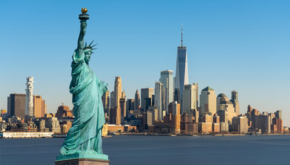 Wall Mural - The Statue of Liberty over Scene of New York cityscape river side which location is lower manhattan which can see One world trade conter, United state of America, USA, Taking from New Jersey skyline