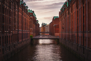 Speicherstadt warehouse district in Hamburg, Germany. Old brick buildings and channel of Hafencity quarter. UNESCO heritage