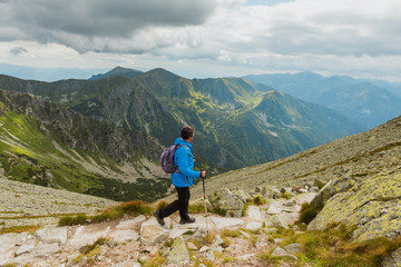Sporty hiker near summer spring in Tatra Mountains national park, Zakopane, Poland