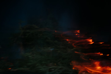 long exposure fire pictures, natural background, selective focus, film and grain