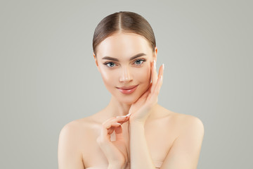 Beautiful woman looking at camera. Healthy spa model girl with clear skin. Skincare and facial treatment concept