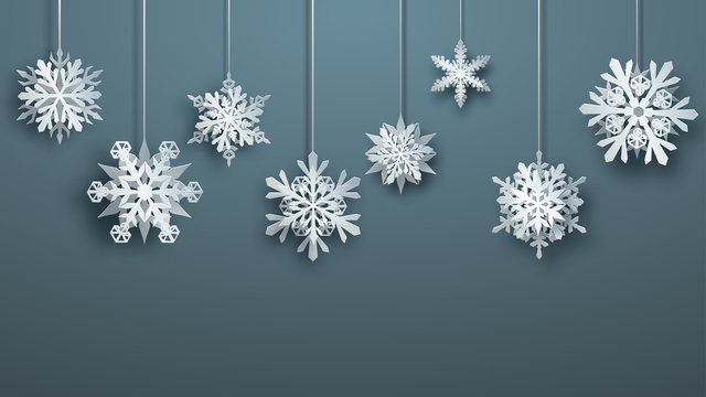 Christmas large complex paper hanging snowflakes on gray background