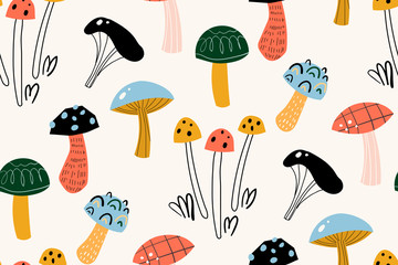 Seamless pattern with decorative mushrooms in the Scandinavian style. Perfect for kids fabric, textile, nursery wallpaper. Beautiful autumn illustration in vector.