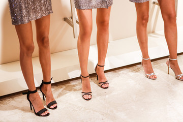 Legs of girls models, backstage of the fashion show at the fashion week