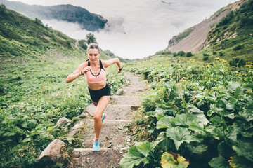 Poster Olive Woman running and jogging in the nature mountain scenery. Concept of healthy lifestyle. Fitness spot girl training in mountain.