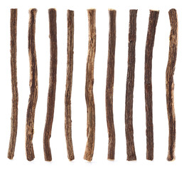 Collage of licorice root on white background