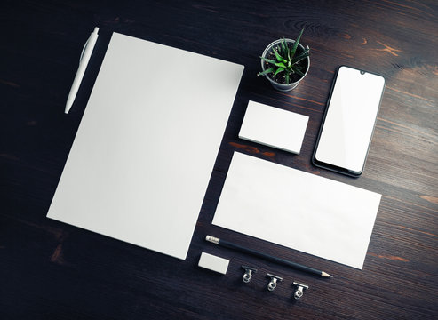 Corporate identity template. Branding mock up. Blank business stationery mock-up on wood table background.