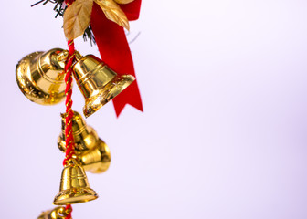 christmas jingle bells with red ribbon and bow