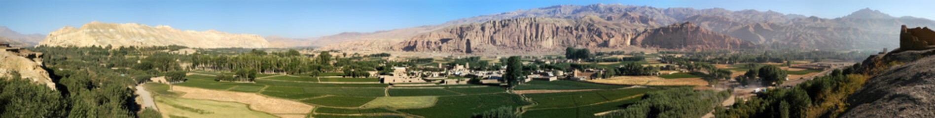 Very large panorama (49MP) of Bamyan (Bamiyan) in Central Afghanistan. This is a view over the Bamyan (Bamiyan) Valley showing both Buddha niches in the cliff. UNESCO site: Afghanistan Buddhas.