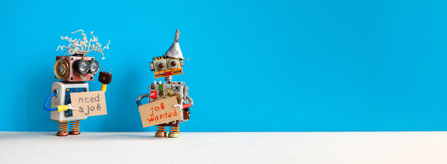 Job search concept. Two robots wants to get a job. Smiley unemployed robotic characters with a cardboard sign and handwritten text Need a job and Job Wanted. Blue gray background, copy space for text