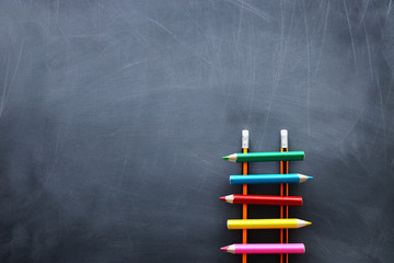 Education concept of Ladder made from pencils over blackboard
