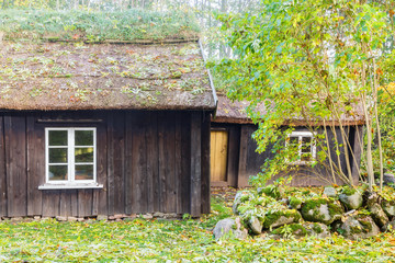 Wall Mural - Old wooden cottage with thatched roof