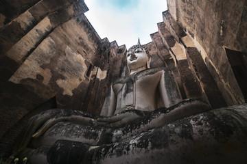 Ancient Big Buddha statue named Phra Ajarn at Wat SriChum Sukhothai Historical Park,  UNESCO World Heritage Site, Sukhothai, Thailand.