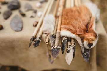 Arrows for bow made in ancient technology with a stone sharp tip and bird feathers