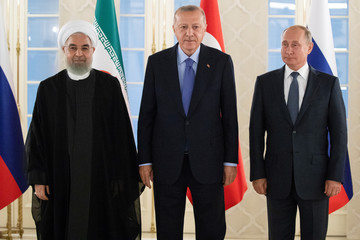 Presidents Hassan Rouhani of Iran, Tayyip Erdogan of Turkey and Vladimir Putin of Russia pose for a picture before their meeting in Ankara
